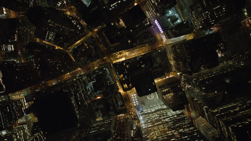 4K stock video aerial view of tilting to a bird's eye view of skyscrapers and streets in Lower Manhattan at night, New York Aerial Stock Footage | AX67_0090