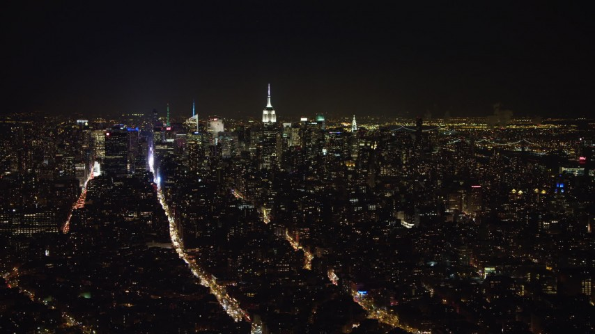 4K stock video aerial view of a wide view of the Midtown skyline at night, New York Aerial Stock Footage | AX67_0092