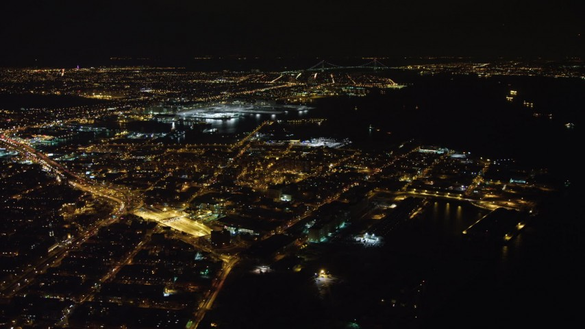 4K stock video aerial view of flying by Red Hook area of Brooklyn at night, New York Aerial Stock Footage | AX67_0098