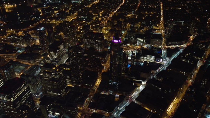 4K stock video aerial view of flying by skyscrapers in Brooklyn at night, New York Aerial Stock Footage | AX67_0101