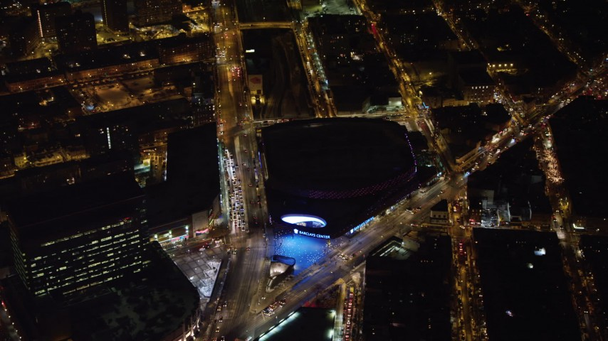 4K stock video aerial view of approaching Barclays Center at night, Brooklyn, New York Aerial Stock Footage | AX67_0102