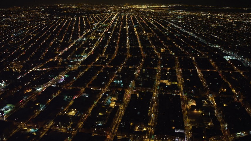 4K stock video aerial view of flying over apartment buildings in Brooklyn at night, New York Aerial Stock Footage | AX67_0103
