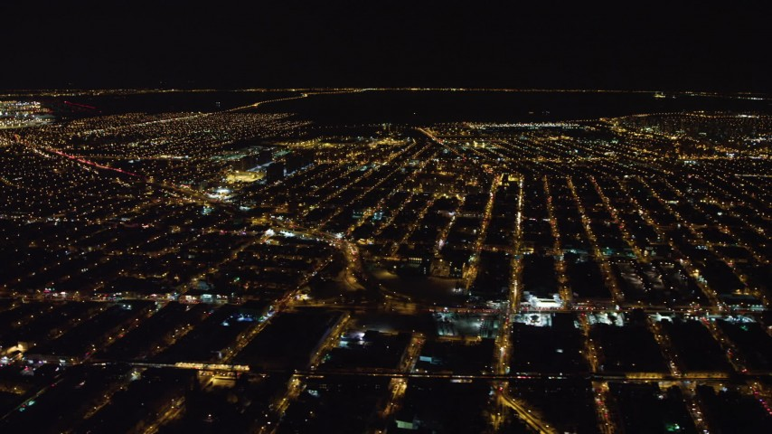4K stock video aerial view of flying by Brooklyn at night, New York Aerial Stock Footage | AX67_0107