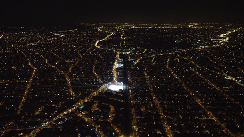 4K stock video aerial view of following train tracks in Queens at night, New York Aerial Stock Footage AX67_0110 | Axiom Images