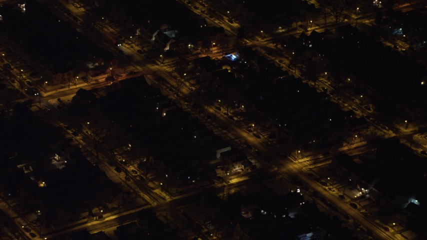 4K stock video aerial view of flying by residential neighborhoods in Queens at night, New York Aerial Stock Footage | AX67_0111