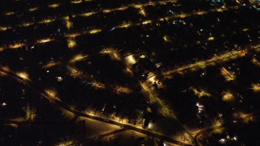 4K stock video aerial view of a bird's eye view of residential neighborhoods in Queens at night, New York Aerial Stock Footage | AX67_0114