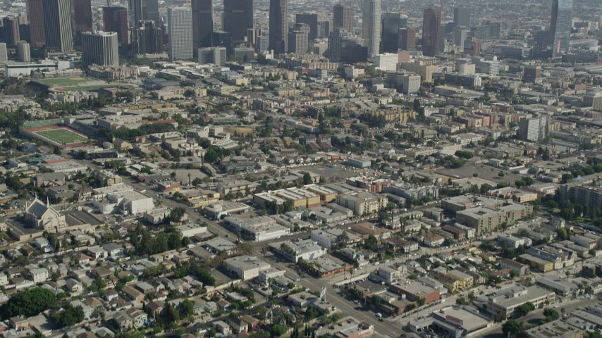 5K stock footage aerial video tilt from Westlake neighborhood to reveal Downtown Los Angeles, California Aerial Stock Footage | AX68_011