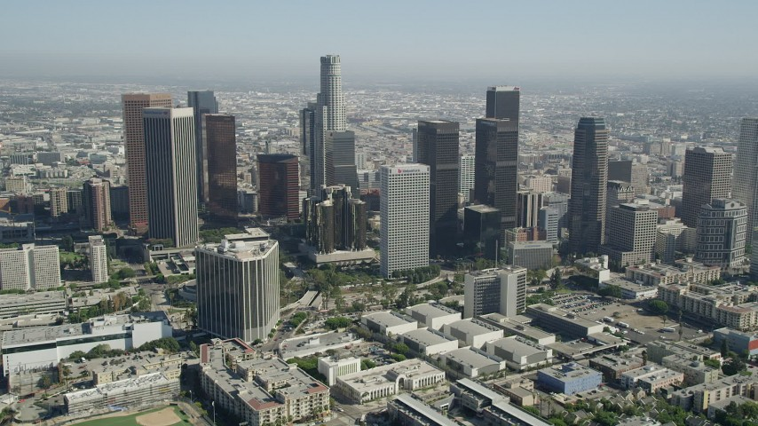 5K stock footage aerial video tilt from Belmont High School to reveal Downtown Los Angeles, California Aerial Stock Footage | AX68_012