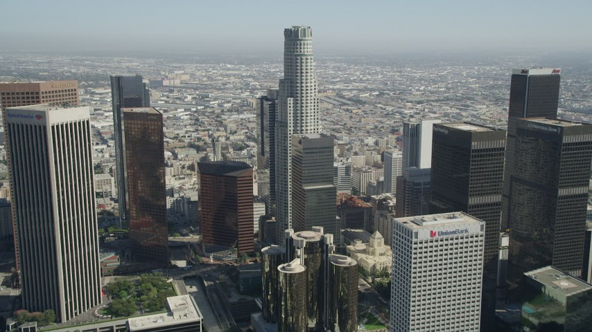 5K stock footage aerial video tilt from office building to reveal and approach US Bank Tower in Downtown Los Angeles, California Aerial Stock Footage | AX68_013