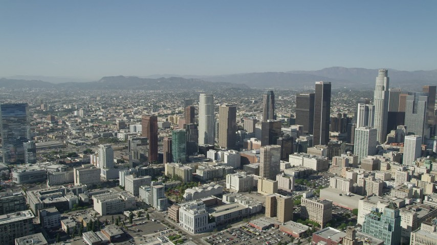 5K stock footage video of passing tall Downtown Los Angeles skyscrapers in California on a sunny day Aerial Stock Footage | AX68_018