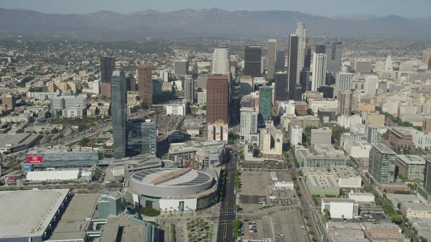 Pan from Staples Center and Ritz-Carlton to reveal Downtown Los Angeles skyscrapers, California Aerial Stock Footage | AX68_019