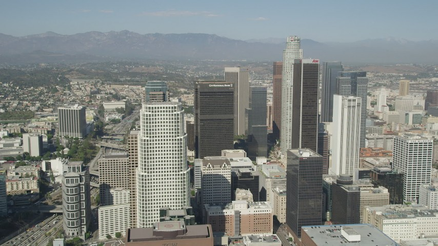 Approach City National Plaza, US Bank Tower, and Aon Center skyscrapers in Downtown Los Angeles, California Aerial Stock Footage | AX68_022