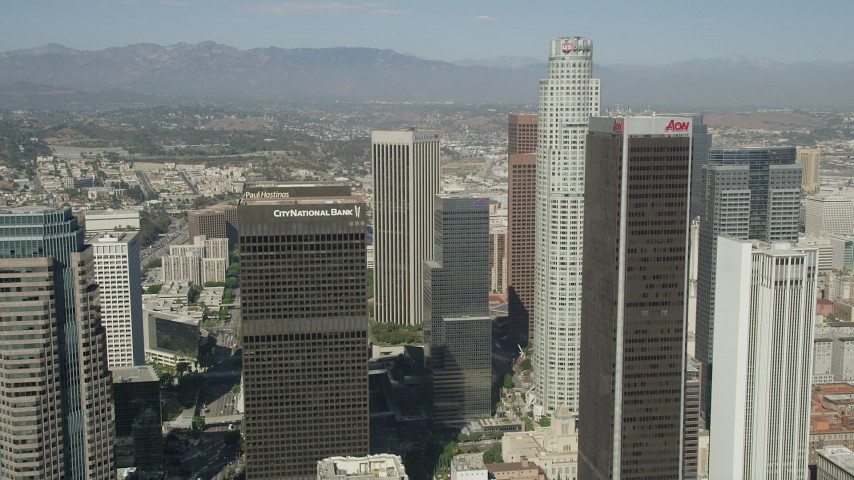 5K stock footage aerial video fly between City National Plaza and Aon Center to approach US Bank Tower in Downtown Los Angeles, California Aerial Stock Footage | AX68_023