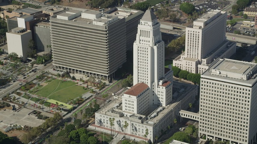 5K stock footage aerial video of passing Los Angeles City Hall in Downtown Los Angeles, California Aerial Stock Footage | AX68_026