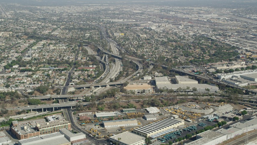 Approach East Los Angeles Interchange in Boyle Heights, Los Angeles, California Aerial Stock Footage | AX68_027