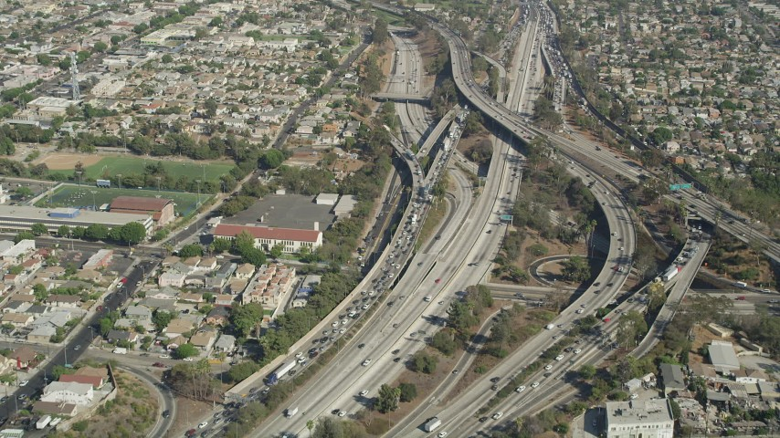 Heavy traffic on the East Los Angeles Interchange in Boyle Heights, Los Angeles, California Aerial Stock Footage | AX68_028