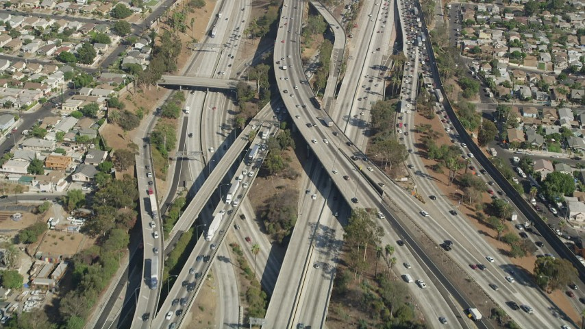 A bird's eye view of heavy traffic on the East Los Angeles Interchange through Boyle Heights, Los Angeles, California Aerial Stock Footage AX68_029