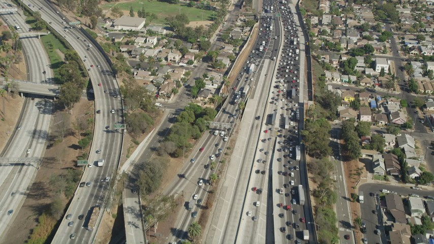 Fly over heavy traffic on Interstate 5 through Boyle Heights, Los Angeles, California Aerial Stock Footage | AX68_030