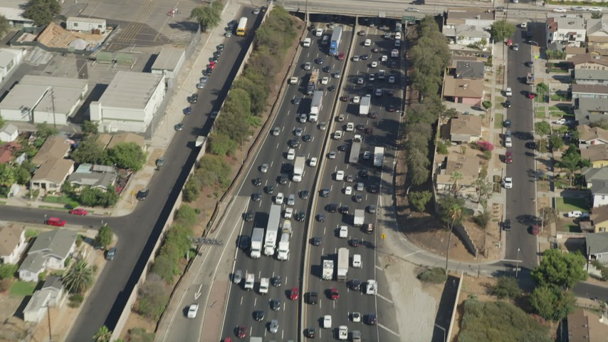 Bird's eye view of heavy traffic on Interstate 5 in Boyle Heights, Los Angeles, California Aerial Stock Footage | AX68_031