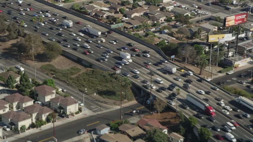 5K stock footage aerial video flyby heavy freeway traffic on Interstate 5 through Boyle Heights, Los Angeles, California Aerial Stock Footage | AX68_033