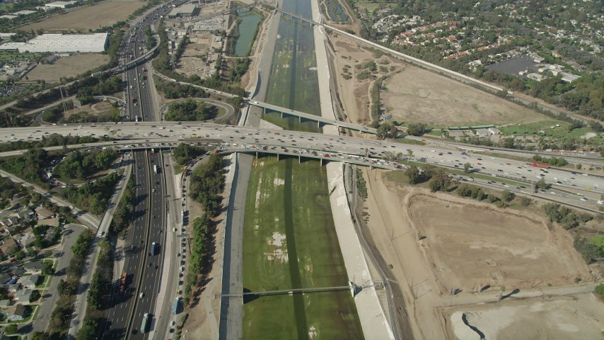 5K stock footage aerial video reverse bird's eye view of the Los Angeles River, reveal freeway interchange in Long Beach, California Aerial Stock Footage | AX68_048