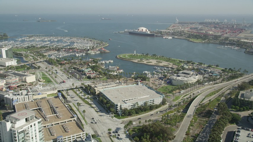 5K stock footage aerial video approach Rainbow Harbor, aquarium, and the Queen Mary in Long Beach, California Aerial Stock Footage | AX68_052