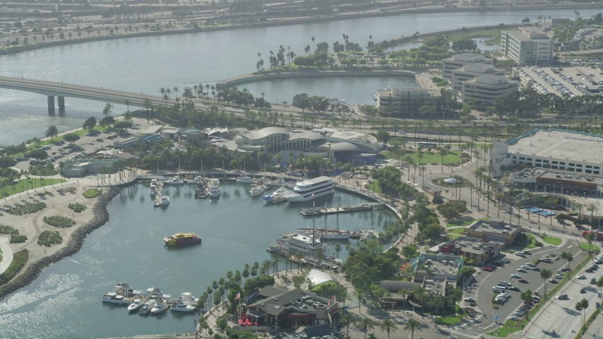 Aquarium of the Pacific and boats on Rainbow Harbor in Downtown Long Beach, California Aerial Stock Footage | AX68_060