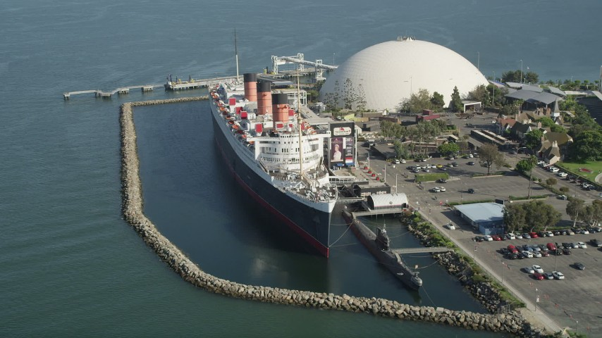 5K stock footage aerial video tilt to reveal the Queen Mary Docked in Long Beach, California Aerial Stock Footage   AX68_064