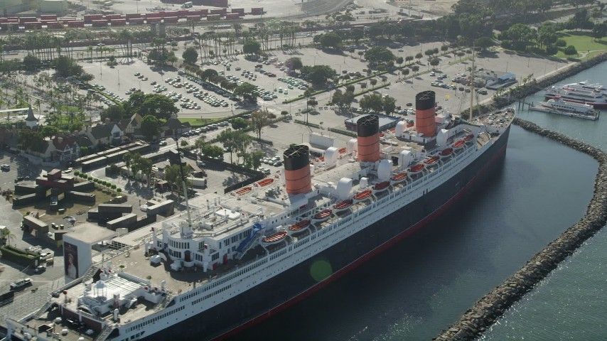 5K stock footage aerial video flyby the RMS Queen Mary docked in Long Beach, California Aerial Stock Footage | AX68_067