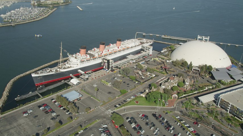 5K stock footage aerial video orbit the bow of the Queen Mary luxury liner in Long Beach, California Aerial Stock Footage | AX68_069