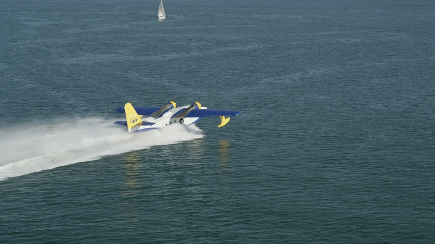 5K stock footage aerial video track seaplane speeding across San Pedro Bay in Long Beach, California Aerial Stock Footage | AX68_076