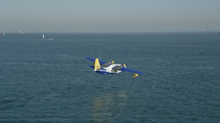 Track seaplane flying over San Pedro Bay in Long Beach, California Aerial Stock Footage | AX68_078