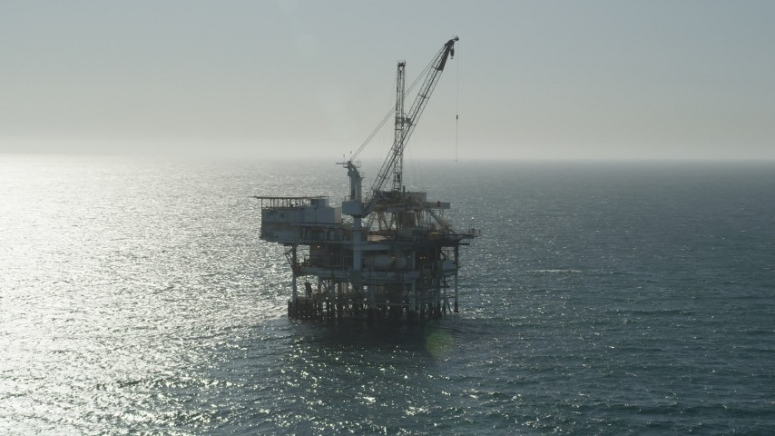 5K stock footage aerial video of orbiting around the side of an oceanic oil platform near Long Beach, California Aerial Stock Footage | AX68_091