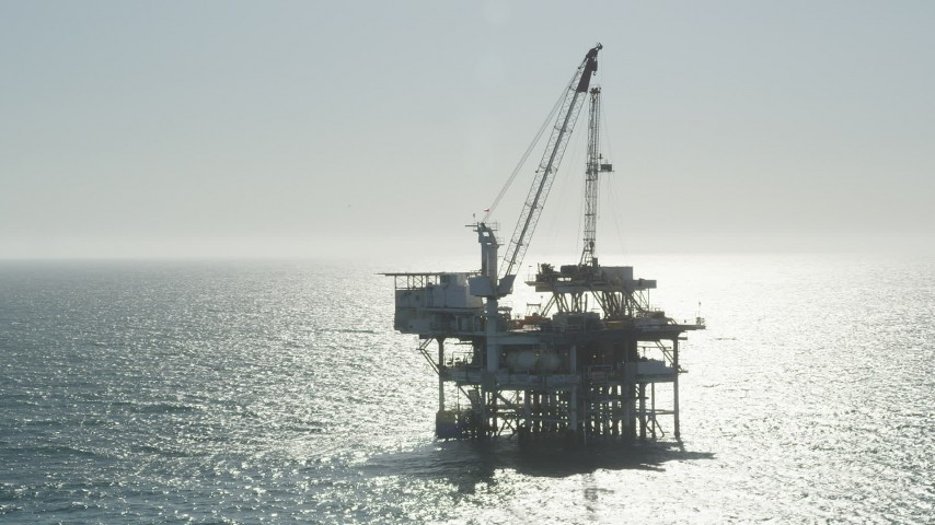 5K stock footage aerial video of circling an oceanic oil platform near Long Beach, California Aerial Stock Footage | AX68_093