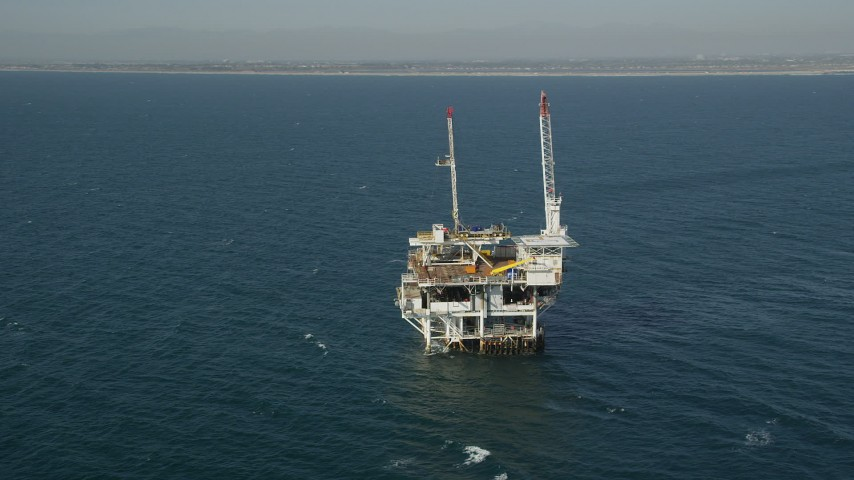5K stock footage aerial video orbit of an oil platform off the California Coast, near Long Beach Aerial Stock Footage | AX68_099
