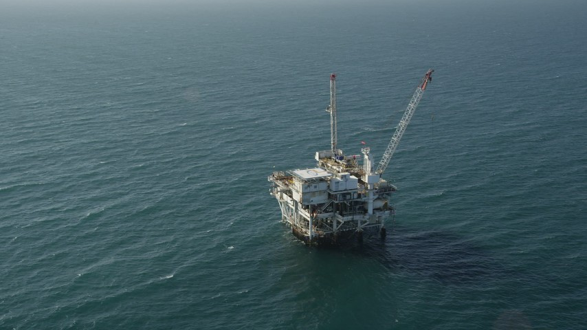 5K stock footage aerial video of circling an oil platform off the California Coast, near Long Beach Aerial Stock Footage | AX68_100