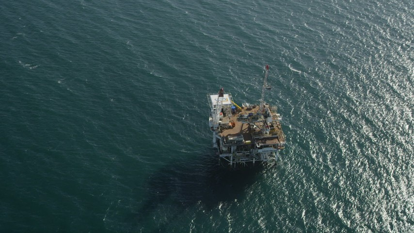 5K stock footage aerial video of bird's eye view of an oceanic oil platform off the California Coast near Long Beach Aerial Stock Footage | AX68_102