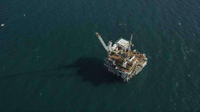 5K stock footage aerial video of bird's eye of an oil drilling platform near the California Coast, Long Beach Aerial Stock Footage | AX68_103