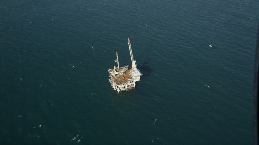 5K stock footage aerial video of a bird's eye of an oceanic oil platform near Long Beach, off the California Coast Aerial Stock Footage | AX68_104