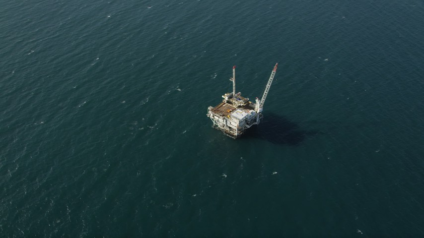 5K stock footage aerial video of looking down at an oceanic oil platform near the coast of California, Long Beach Aerial Stock Footage | AX68_105