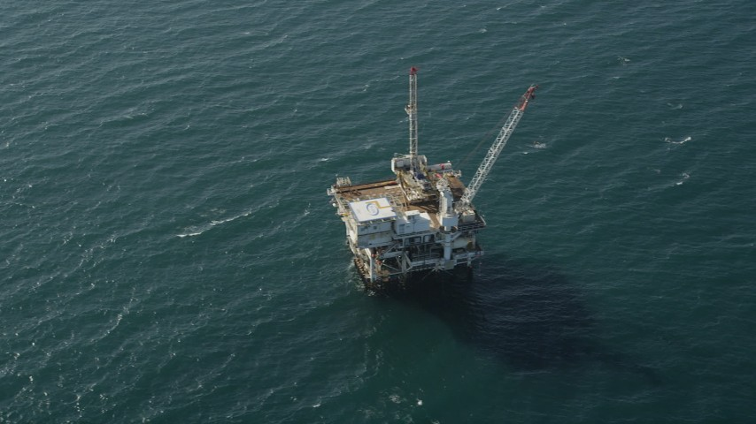 Flyby an oil platform just off the California Coast, Long Beach Aerial Stock Footage | AX68_106