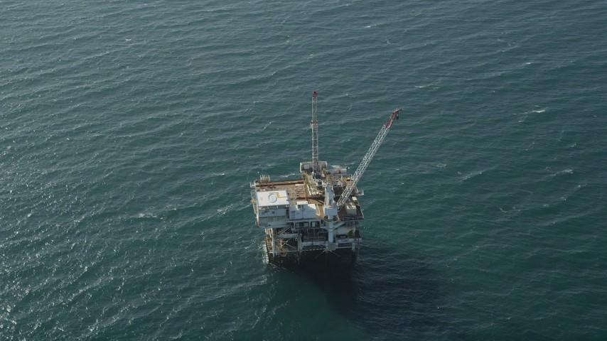 5K stock footage aerial video of flyby an oil platform just off the California Coast, Long Beach Aerial Stock Footage | AX68_106