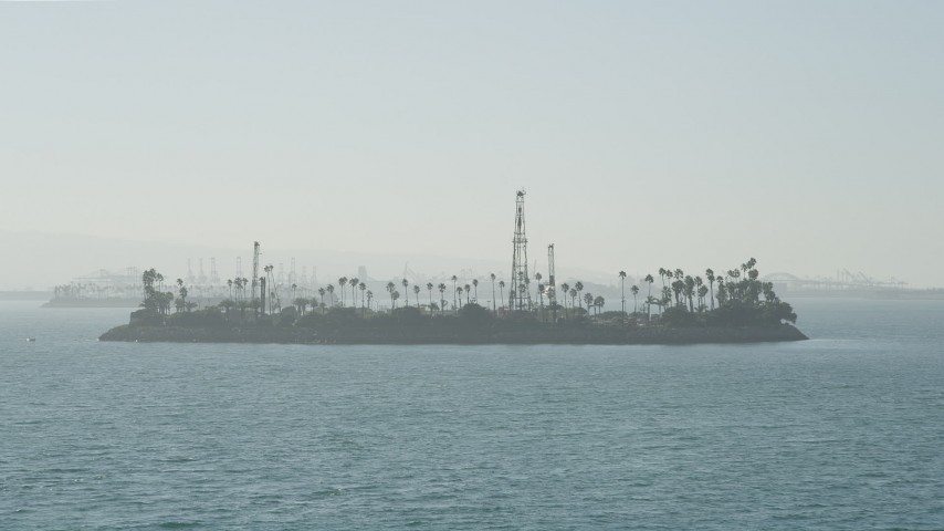 5K stock footage aerial video approach the oil drilling Island Chaffee in San Pedro Bay, Long Beach, California Aerial Stock Footage | AX68_126