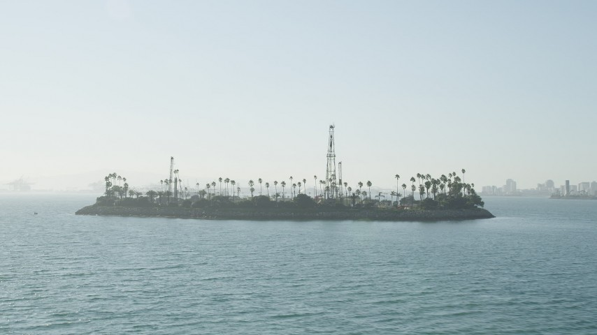 5K stock footage aerial video of an approach to Island Chaffee in San Pedro Bay, Long Beach, California Aerial Stock Footage   AX68_127