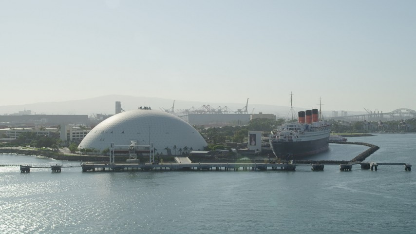 5K stock footage aerial video approach the Long Beach Cruise Terminal and Queen Mary in Long Beach, California Aerial Stock Footage | AX68_133