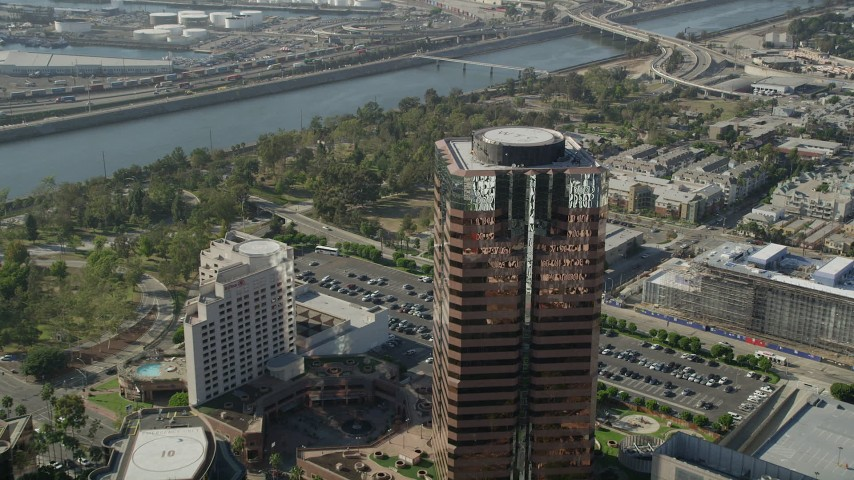 5K stock footage aerial video approach and fly over a modern office building in Downtown Long Beach, California Aerial Stock Footage | AX68_138