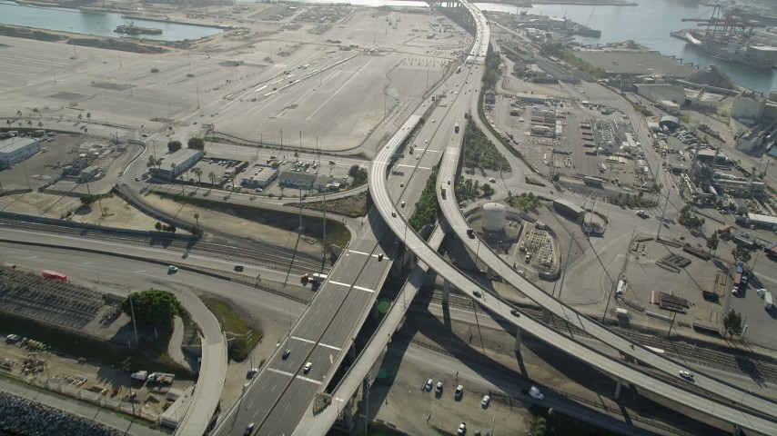 5K stock footage aerial video follow I-710 with light traffic through Port of Long Beach, California Aerial Stock Footage | AX68_139