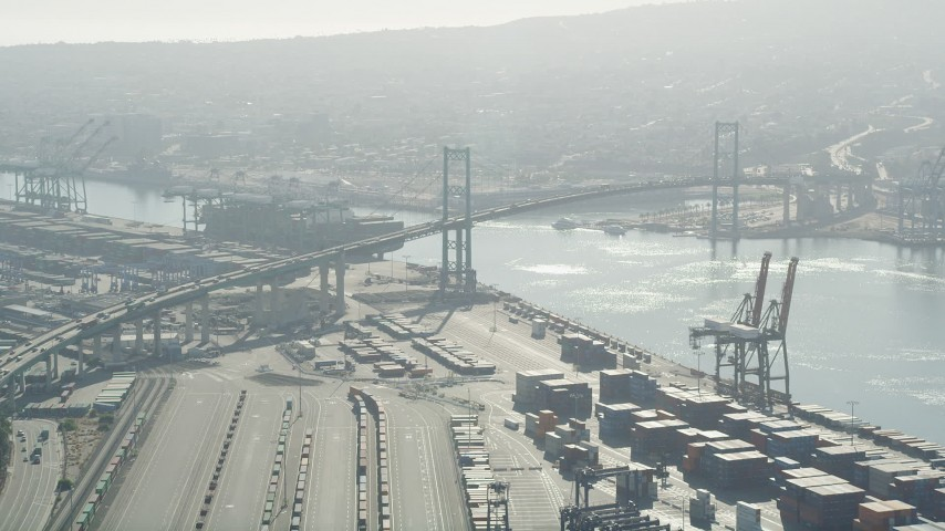 Approach the Vincent Thomas Bridge with light traffic at Port of Los Angeles, California Aerial Stock Footage | AX68_146