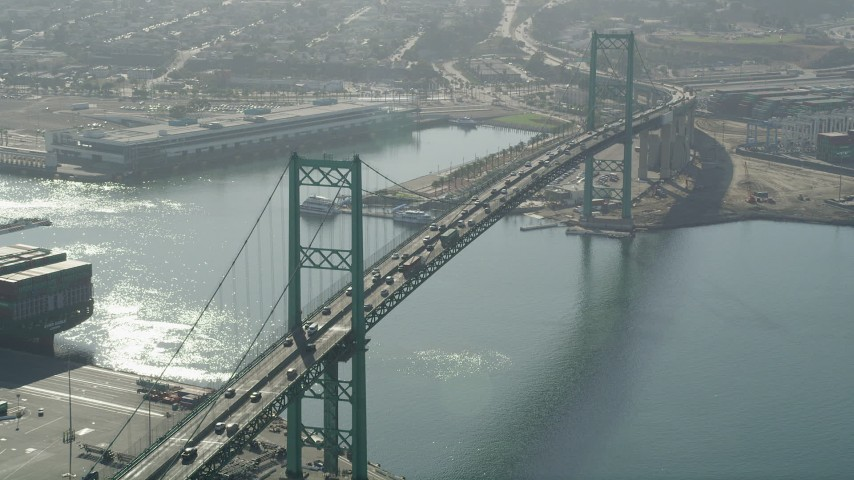 Approach cars crossing the Vincent Thomas Bridge in the Port of Los Angeles, California Aerial Stock Footage | AX68_148