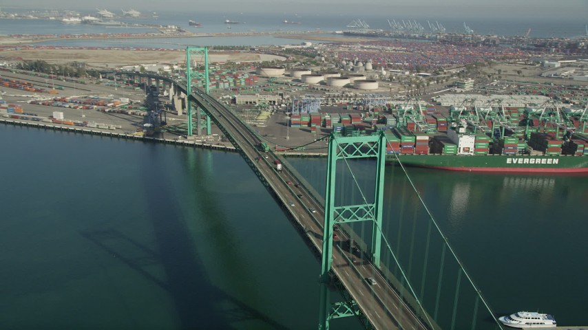5K stock footage aerial video of cars and trucks crossing the Vincent Thomas Bridge at the Port of Los Angeles, California Aerial Stock Footage AX68_151